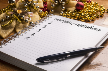 notebook for new years resolutions and a pen
