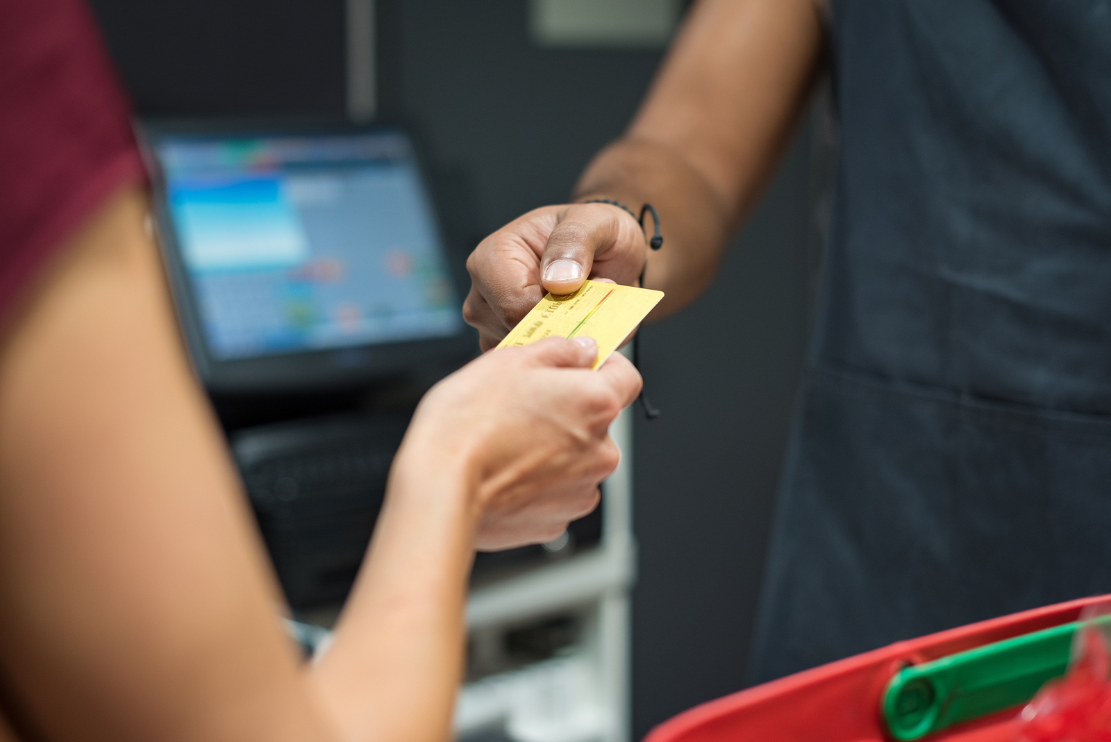 A unified POS system will help keep your font end operations, like in this image of a woman using credit card to pay at supermarket integrated with your back end reports and analytics.