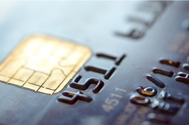 close-up on a credit card chip and the first digits of the credit card