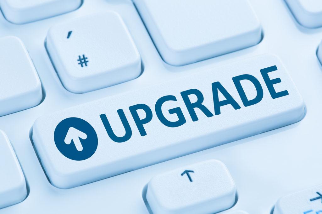 Upgrade upgrading software program symbol blue computer keyboard