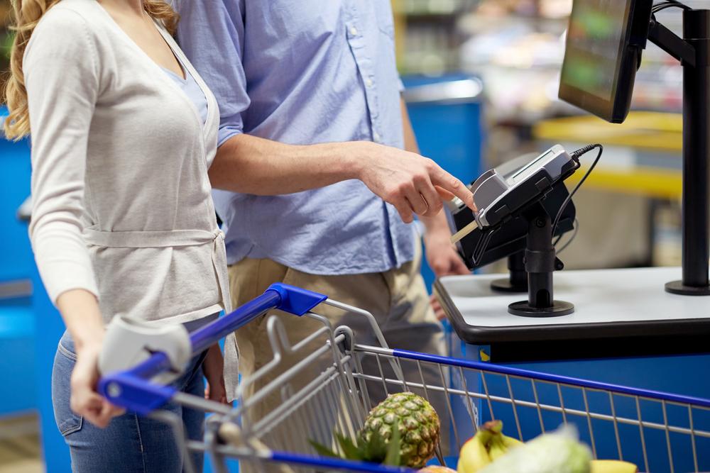 Customers using self-checkout