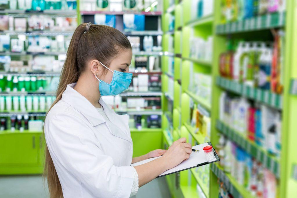 Female pharmacist checks medications.