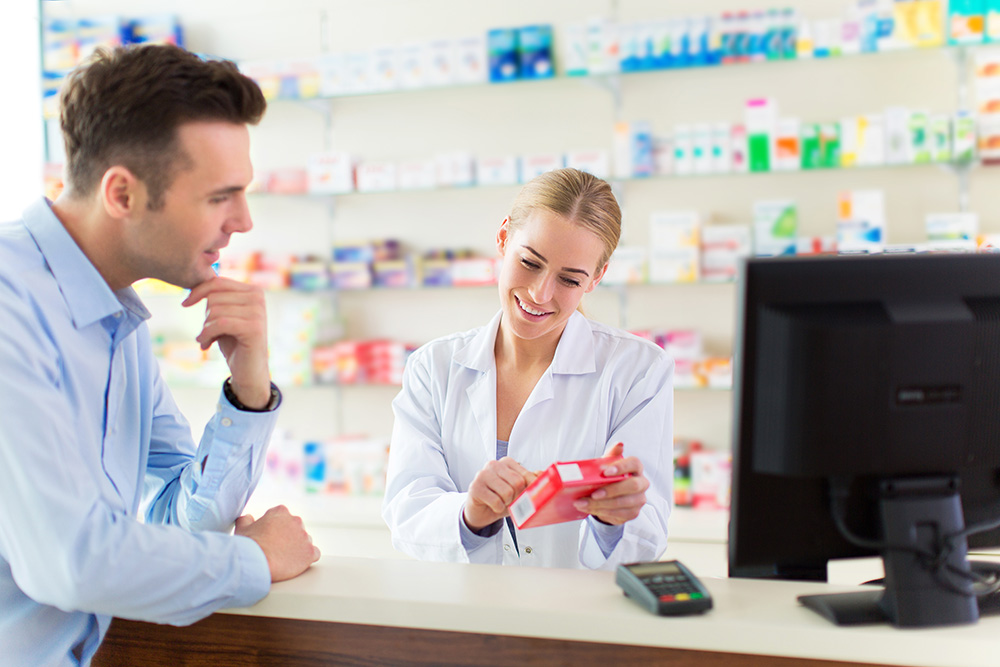 pharmacist helping customer with a product