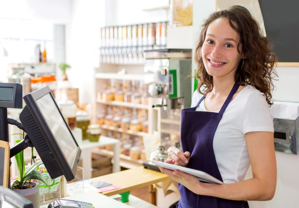 health store employee smiles at the checkout